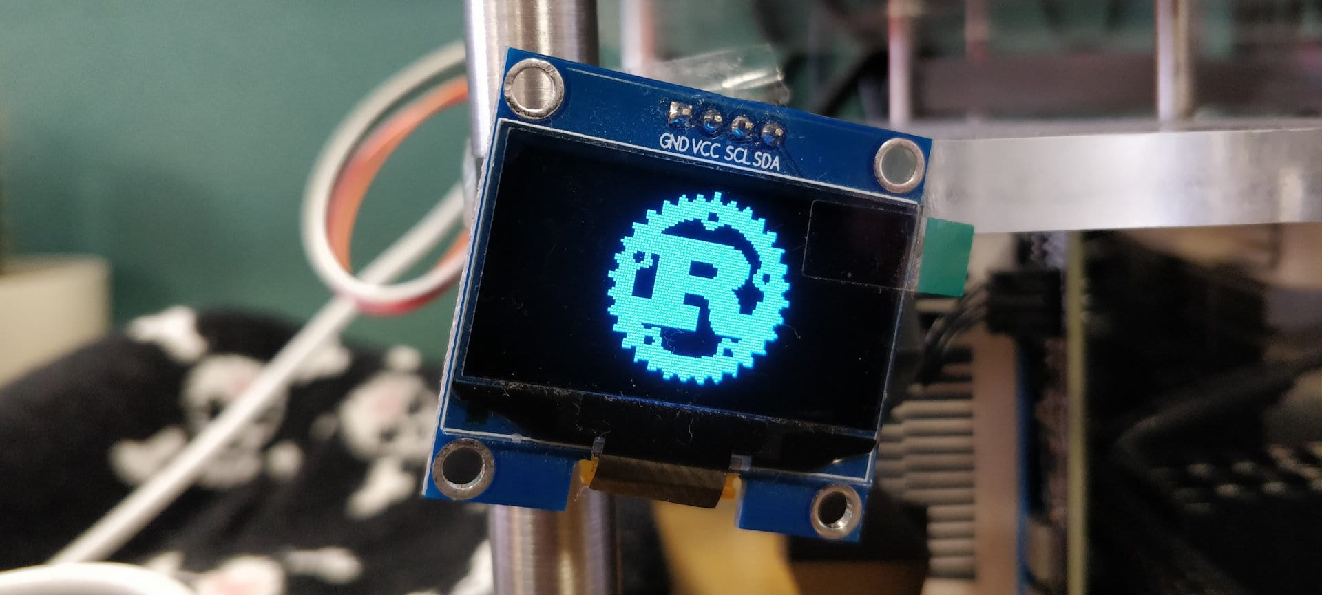 SH116 display module showing the Rust logo