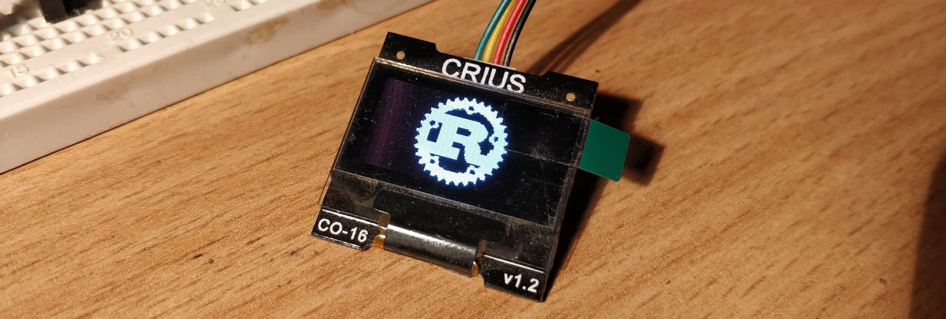 CRIUS display showing the Rust logo