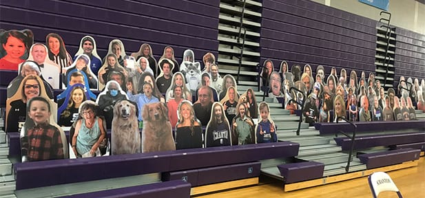 Men's and Women's Basketball Compete, Cardboard Cutouts are Fans